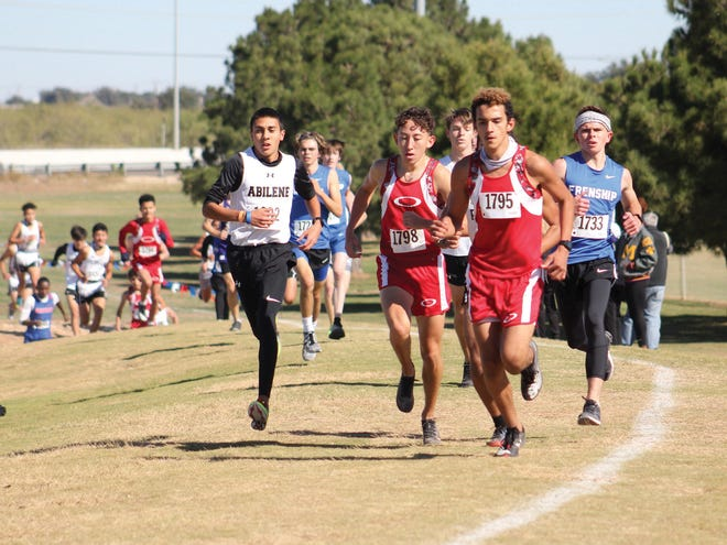 From left to right: Abilene High's Andruw Villa, Odessa High's Adrian Lujan, Odessa High's Alex Camacho and Wolfforth Frenship's Collin Turley run during the District 2-6A cross country meet Thursday at UTPB Park in Odessa.