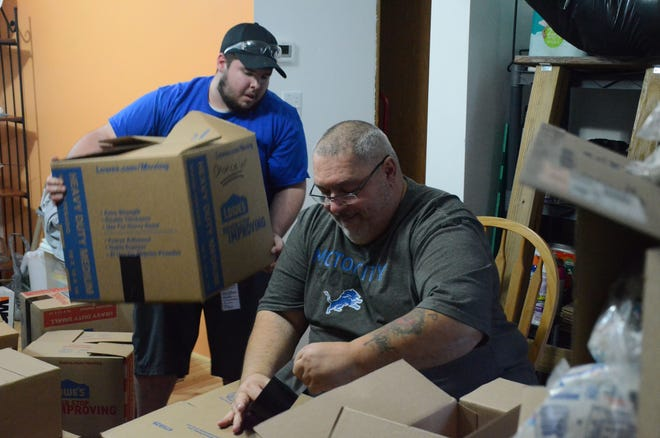 Alphonse Bifulco,  right, and Chancelor Gillem packing boxes for Thanksgiving meals.