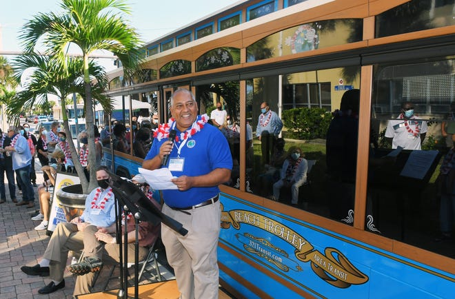 Cocoa Beach Mayor Ben Malik speaks during the 10 Days of Trolley kickoff ceremony, held in front of Cocoa Beach City Hall on Friday, as local officials and community members toured and rode in one of the new trolley-style buses that will be a part of the Space Coast Area Transit Route 9 from Port Canaveral to Cocoa Beach.