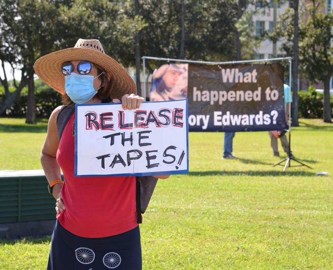 A group of protesters gathered Friday afternoon outside the Moore Justice Center at the intersection of Stadium Parkway and Judge Fran Jamieson Way in Viera. They were calling for the release of the Gregory Edwards jail tape as a hearing over the issue proceeded in the courthouse.