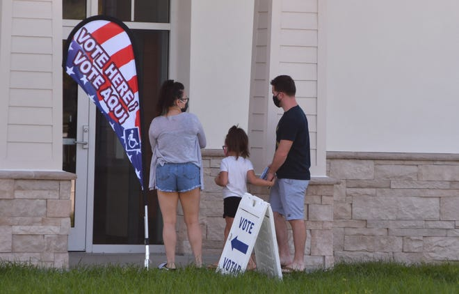 Voters head in to cast ballots on Friday at an early voting site at the Joe Lee Smith Community Center in Cocoa.