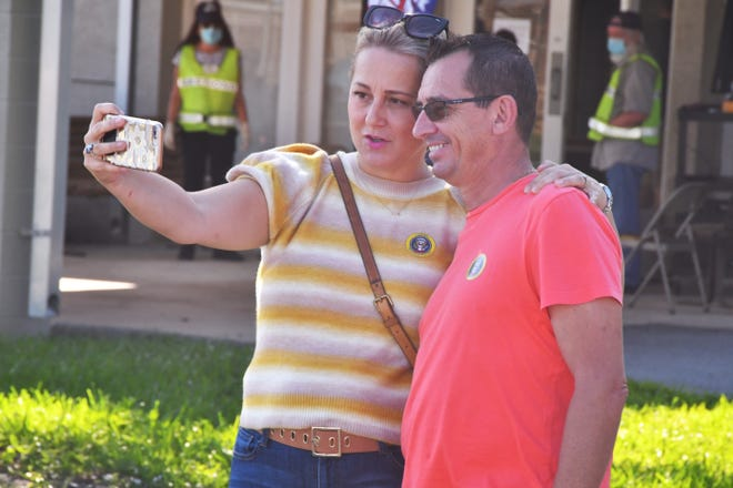 A trend this year among voters is selfies, with the voting signs behind them after they vote. Corolia and Alain Mazaudon took a selfie Friday after voting at an early-voting site at Kiwanis Island Park on Merritt Island.