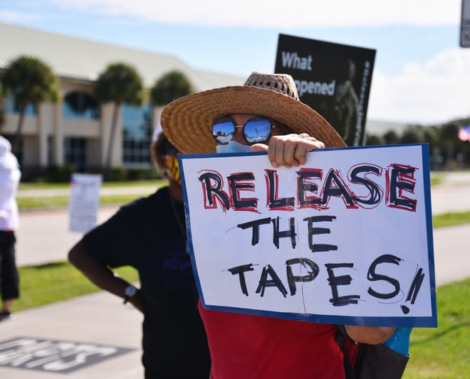 A group of protesters gathered recently outside the Moore Justice Center at the intersection of Stadium Parkway and Judge Fran Jamieson Way in Viera. They were asking for the release of the jail tapes of Gregory Edwards, a hearing was going on in the courthouse over the release of the tapes.