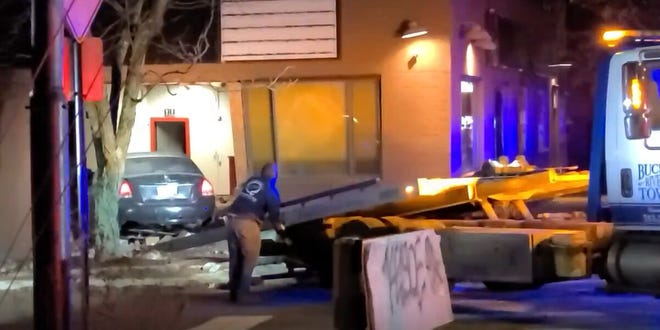 A police chase ended with a crash into a building in Cheviot and at least one person going to a hospital early Friday, according to Hamilton County dispatchers.