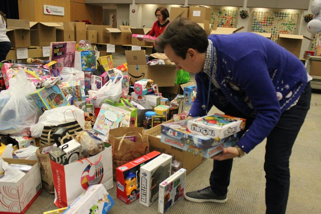 A Cincinnati Children's Hospital Medical Center waiting area is filled with toys for a holiday gift drive. This year, the center will not accept toys this way. Instead, a Holiday Bundle Campaign lets people donate online.