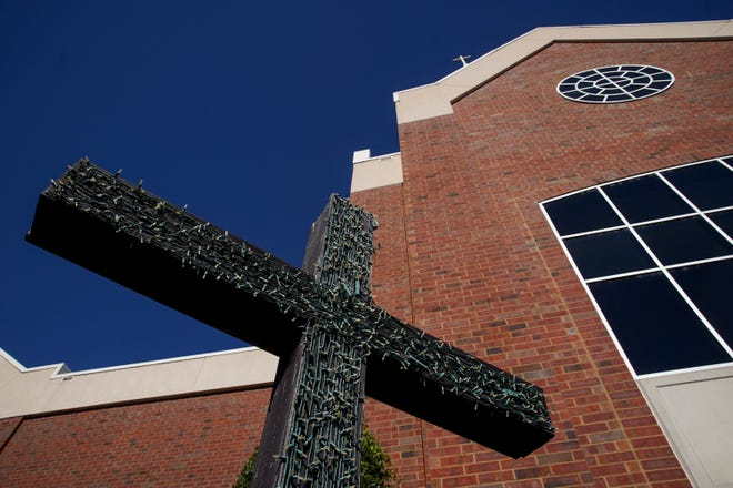 Lights adorn a cross set up in front of the main sanctuary of the campus at First Baptist Church in Clarksville, Tenn., on Friday, Oct. 30, 2020.