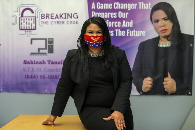 Sakinah Tanzil, 43, of Southfield recently wrote a book that guides young people in the cybersecurity industry and stands in front of Southfield Chamber of Commerce where she is a member on Oct. 30, 2020.