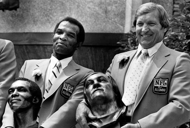 Herb Adderly and Jim Otto pose with their busts after enshrinement in the Pro Football Hall of Fame in Canton, Ohio, Aug. 2, 1980.