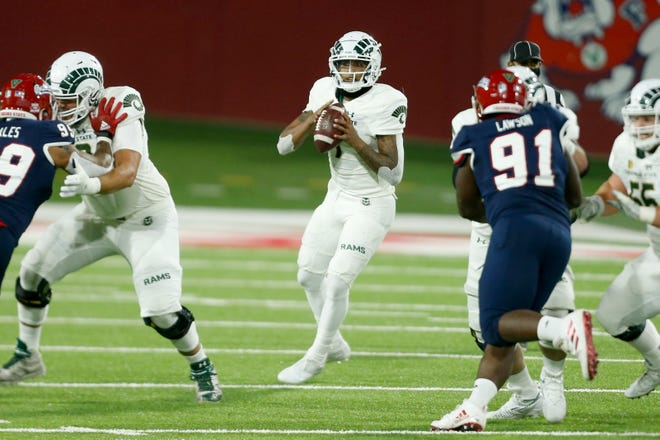 Colorado State Rams quarterback Todd Centeio (7) looks to pass the ball during the first quarter against the Fresno State Bulldogs at Bulldog Stadium on Oct. 29, 2020.