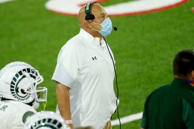 Colorado State Rams head coach Steve Addazio watches a replay during against the Colorado State Rams during the third quarter at Bulldog Stadium on Oct. 29, 2020. Fresno State defeated Colorado State 38-17.