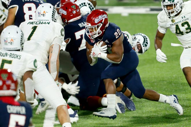 Fresno State Bulldogs running back Ronnie Rivers (20) rushes for a touchdown during the third quarter against the Colorado State Rams at Bulldog Stadium on Oct. 29, 2020. Fresno State defeated Colorado State 38-17