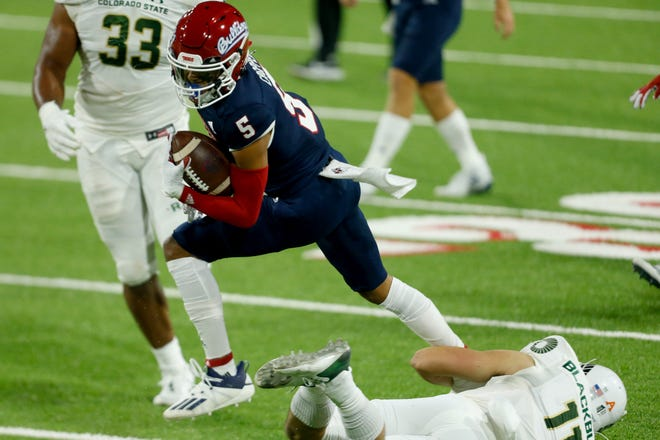 Fresno State Bulldogs wide receiver Jalen Cropper (5) runs with the ball against Colorado State Rams defensive back Henry Blackburn (11) during the first quarter at Bulldog Stadium on Oct. 29, 2020.