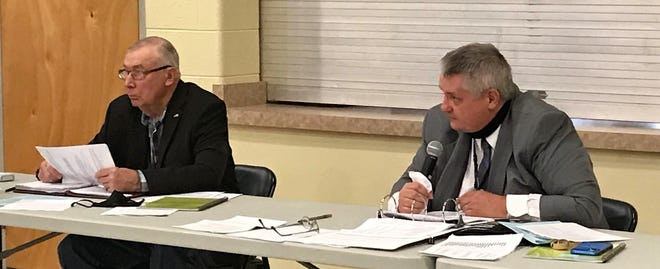 Kevin Hamann, right, the administrative coordinator for Oconto County, speaks during the County Board's budget meeting Oct. 29 at Holy Trinity Parish Hall in Oconto. At left is board chairman Paul Bednarik.