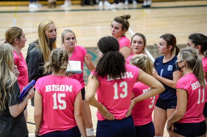 Great Falls High head coach Taylor Parker (left) huddles with her team during last Thursday's crosstown volleyball match against CM Russell at the CMR Fieldhouse.