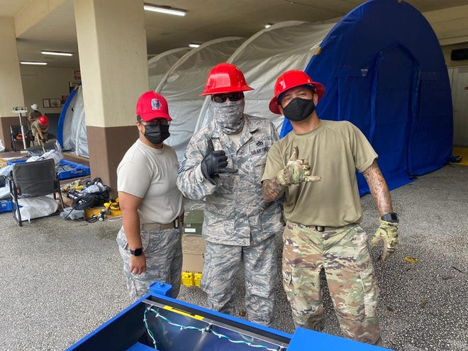 Airmen with the Guam National Guard's 254th Red Horse Squadron erect Blu-Med tents outside Guam Memorial Hospital's emergency room in this Oct. 30 file photo. Two Guam AirNationalGuard members saved an unconscious person aboard a military ship.