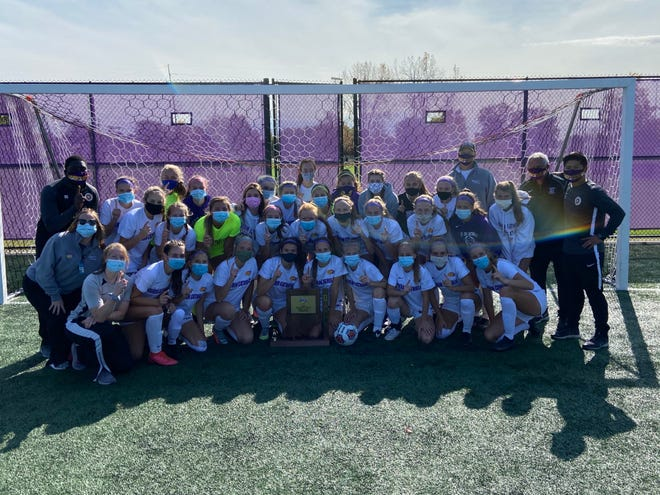 The Guerin Catholic girls soccer team celebrates after its Class 3A Semistate win over Columbus North.