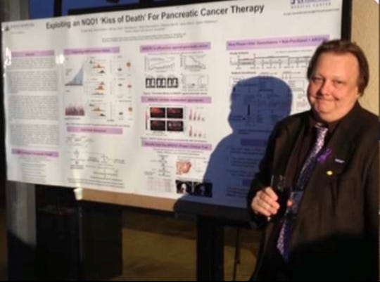 """David Boothman during a presentation on his """"Kiss of Death"""" approach to treating pancreatic cancer."""