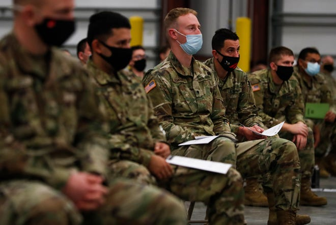 Approximately 400 Indiana National Guard soldiers sit in lecture to prepare for their upcoming mission supporting long-term care facilities throughout Indiana at Camp Atterbury Rail Operationsin Edinburgh, Ind., Friday, October 30, 2020. The Guard soldiers will support the facilities by assisting with testing, reporting test results, screening employees and ensuring infection control practices are in place.