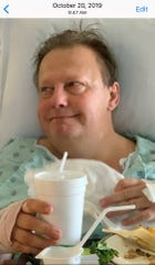 David Boothman eating breakfast in his room at Eskenazi hospital two days after suffering a stroke.