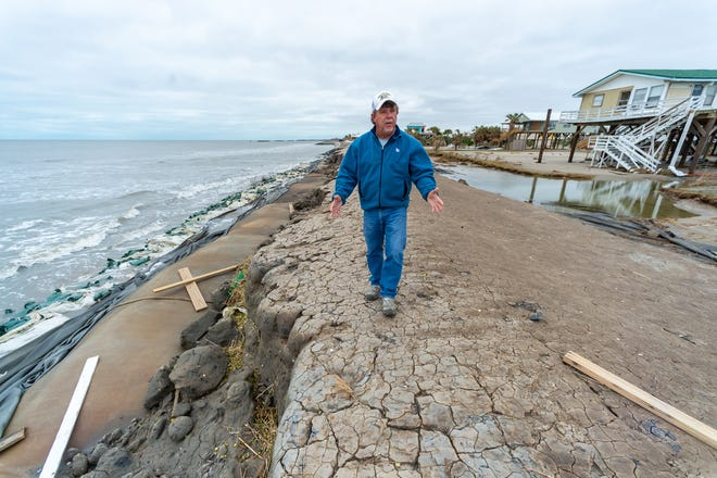 Mayor David Camardelle discussing issues with repairing the levee after Hurricane Zeta causes damage to Grand Isle Friday.