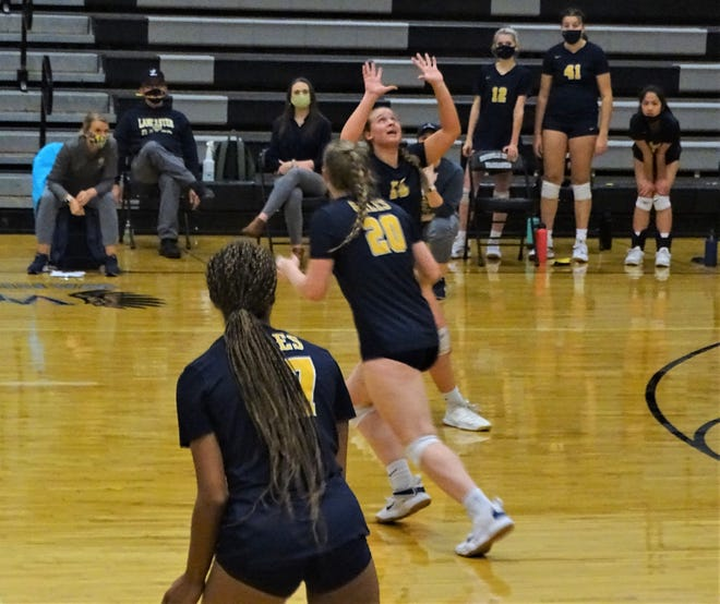 Lancaster's Campbell Noland sets the ball during the Golden Gales Division I district semifinal game against Westerville Central Thursday night. Lancaster, 3-0.