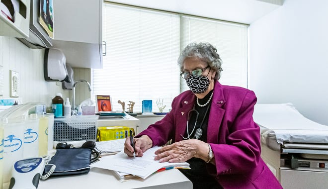 Dr. Barbara Hummel fills out paperwork at her office in Greenfield, WI. on Friday, Oct. 30, 2020. She has been serving patients in the Milwaukee area since 1995, however her practice has seen a dramatic decline in business due to the COVID-19 pandemic.