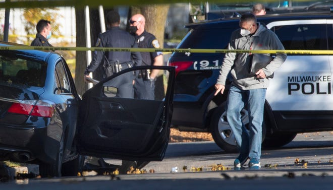 Law enforcement personnel investigate a crime scene Friday, October 30, 2020 near N. 40th St. and W. Custer Ave. in  Milwaukee, Wis.