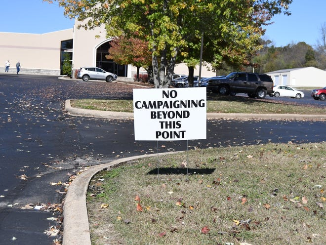 A sign posted at the entry to the parking lot of Mountain Home's First United Methodist Church denotes the 100-foot mark beyond which electioneering is no longer allowed.