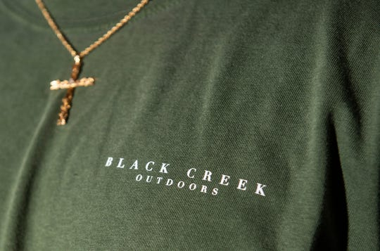Founder Jonathan Robinson models apparel from his brand Black Creek Outdoors in Montgomery, Ala., on Thursday, Oct. 29, 2020.
