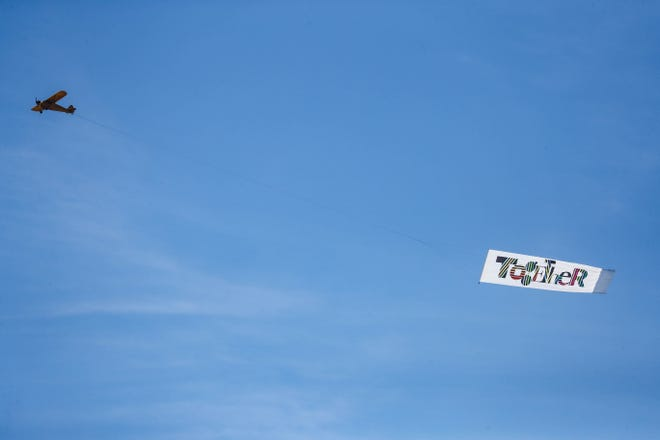 """An airplane ferrying a banner with the word """"Together"""" printed on it flew over Las Cruces on Friday, Oct. 30, 2020."""