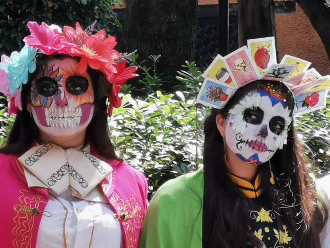"Two women dressed up as ""Catrinas"" for the Día de Muertos celebrations in Mexico City."