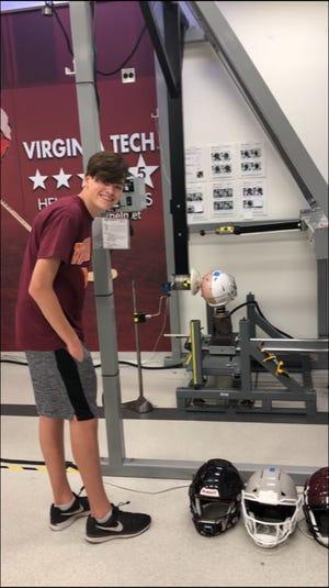 JT Mulvihill tests his football helmet prototypes at Virginia Tech's Helmet Lab.