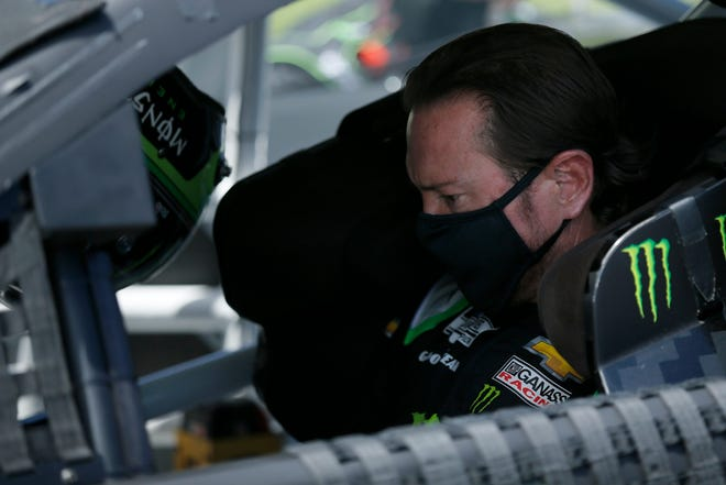 Monster Energy NASCAR Cup Series driver Kurt Busch (1) climbs into his car at the start of the NASCAR Cup Series 10th Annual Quaker State 400 at Kentucky Speedway in Sparta, Ky., on Sunday, July 12, 2020.