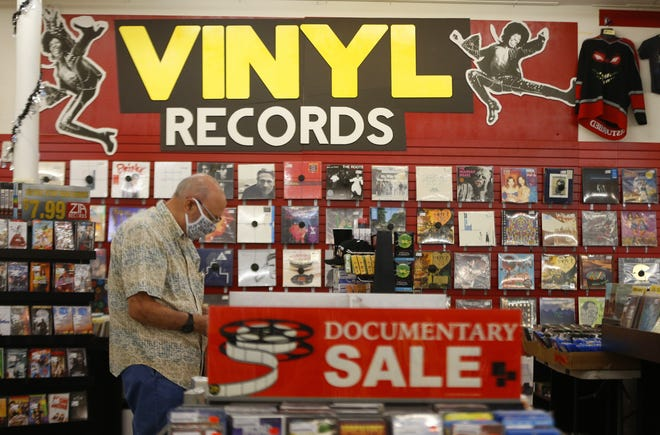 Vinyl records line the walls and isles at Zia Records in Phoenix, Ariz. on Oct. 29, 2020.