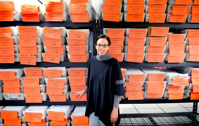 President of the York County Board of Elections Julie Wheeler poses with scanned mail-in ballots stored in a room at the York County Administration Center Friday, Oct. 30, 2020. The room is equipped with a fire suppression system. Bill Kalina photo