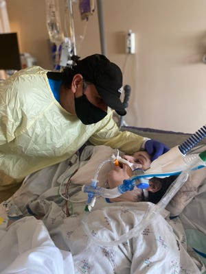 Jose Gonzalez visits his daughter Tania Gonzalez at Renown Medical Center in the final days of her life.
