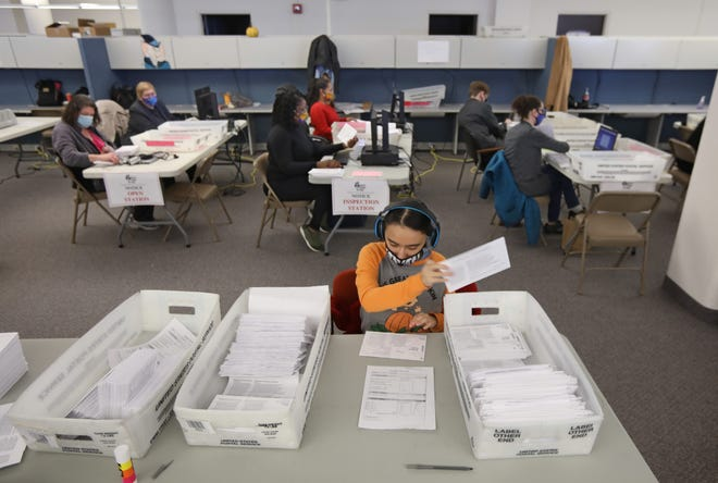 Monroe County Board of Elections staffers work to process some of the thousands of absentee ballots received as of Friday, Oct. 30, 2020 in downtown Rochester ahead of the Nov. 3, 2020 election.