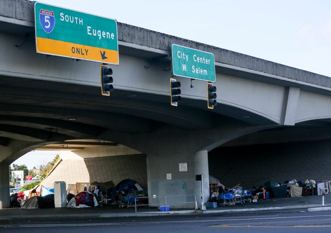 A homeless community on Market Street NE under the Interstate 5 overpass. An Albany man's invention, 'Sleep Trailers,' may help those in need of shelter.