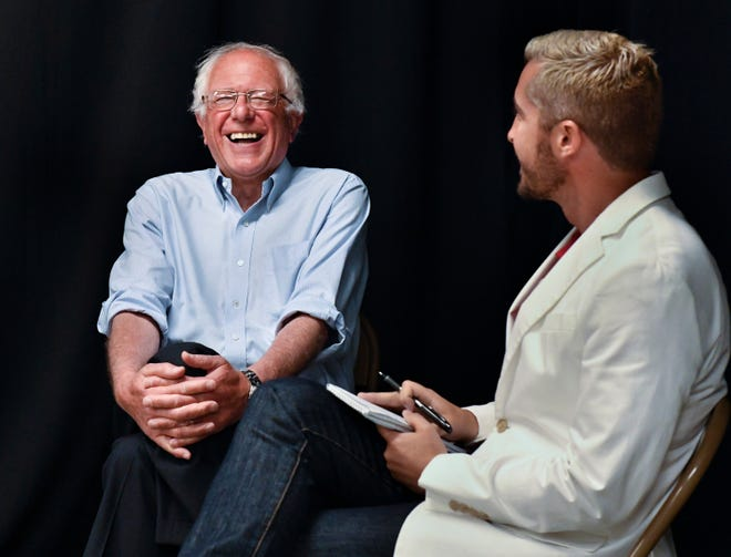 Presidential candidate Bernie Sanders, left, reacts Sunday, May 29, 2016 to Donald Trump's recent statement about California not having a drought during an interview with the Times-Delta's Eric Woomer before Sunday's rally at Groppetti Community Stadium in Visalia.