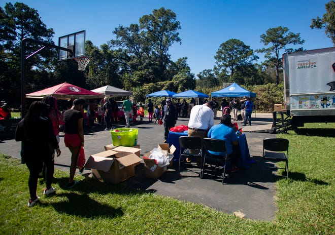 Residents of the Griffin Heights Apartments complex enjoy an afternoon at a fall festival hosted by several community partners including Second Harvest and The Moore Agency.
