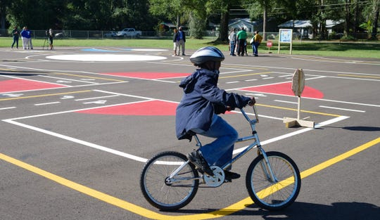 A student rides a bicycle on Sabal Palm Elementary's new educational bicycle park on Friday, Oct. 30, 2020.