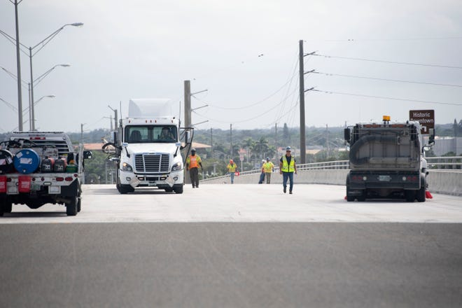 As subcontractors finishing sealing the southbound span of the Roosevelt Bridge, Florida Department of Transportation District Four staff give a tour of the project Friday, Oct. 30, 2020, in Stuart. Two lanes of the newly sealed southbound span of the Roosevelt Bridge are anticipated to reopen Nov. 7, allowing trucks to pass over the bridge and detours to be removed, according to FDOT District Four Secretary Gerry O'Reilly.