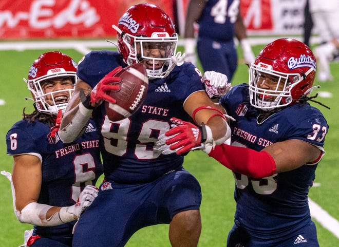 Fresno State's David Perales, center, celebrates his fumble recovery from Colorado State quarterback Todd Centeio with Levelle Bailey, left, and Fresno State's Kwami Jones on Thursday, October 29, 2020.