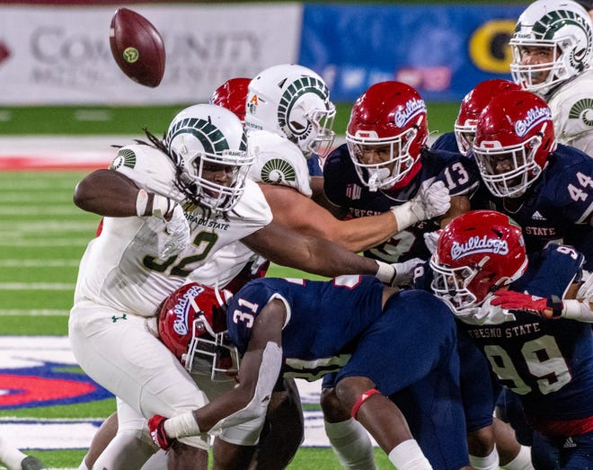 Colorado's Marcus McElroy, Jr. fumbles under pressure from Fresno State's Sherwin King Jr. (31) on Thursday, October 29, 2020. Colorado recovered.