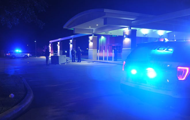 Wichita Falls police investigate the scene of another ATM burglary Friday morning.