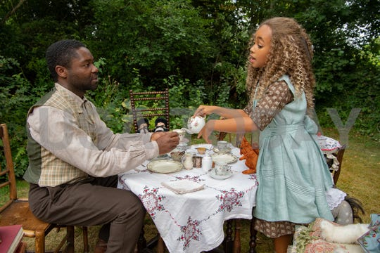 """Jack Littleton (David Oyelowo) has a make-believe tea party with his daughter Alice (Keira Chansa) in """"Come Away,"""" a fantasy drama that reimagines the origin stories of Peter Pan and Alice in Wonderland."""