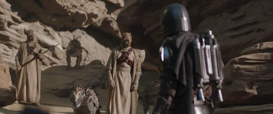"Tusken Raiders talk to the Mandalorian (Pedro Pascal) in the season premiere of ""The Mandalorian."""