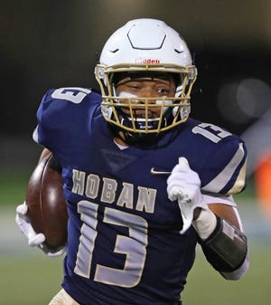 Hoban receiver Shawn Parnell sprints down the sideline on a kick return during the first half against Benedictine on Friday.