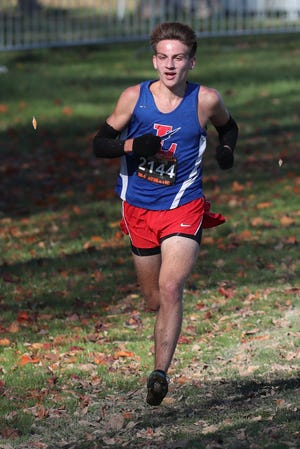 Lake senior Nathan Moore finishes first Saturday at the Division I Cross Country Regional Tournament at Boardman High School.