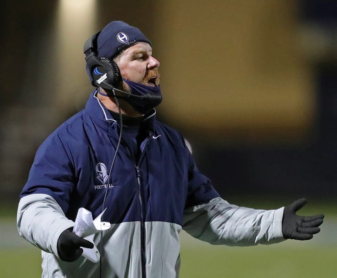 Hoban football coach Tim Tyrrell works the sideline during the second half of a Division II regional semifinal football game against Benedictine, Friday, Oct. 30, 2020, in Akron, Ohio. [Jeff Lange/Beacon Journal]